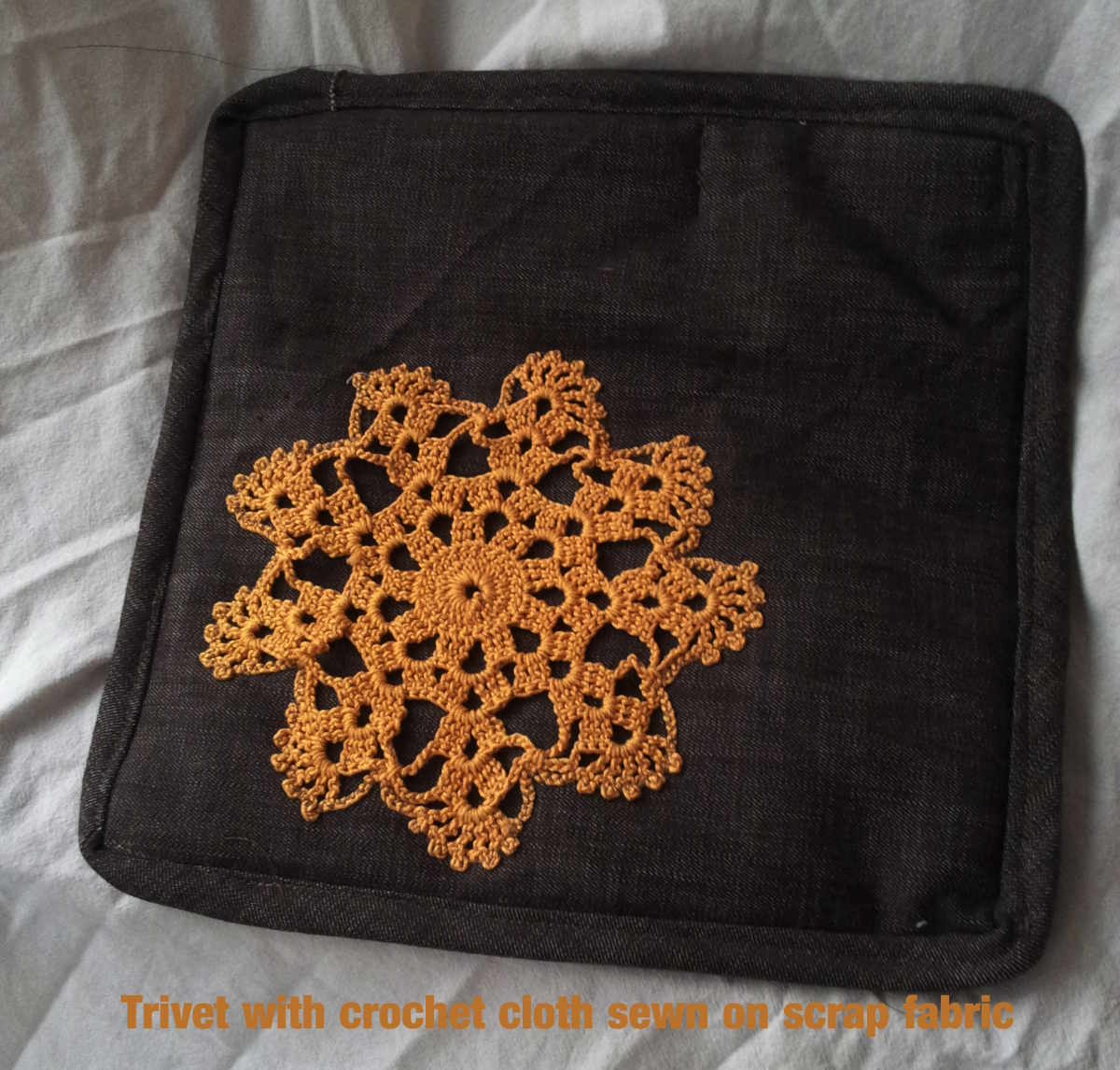 Trivet with crochet cloth on scrap fabric